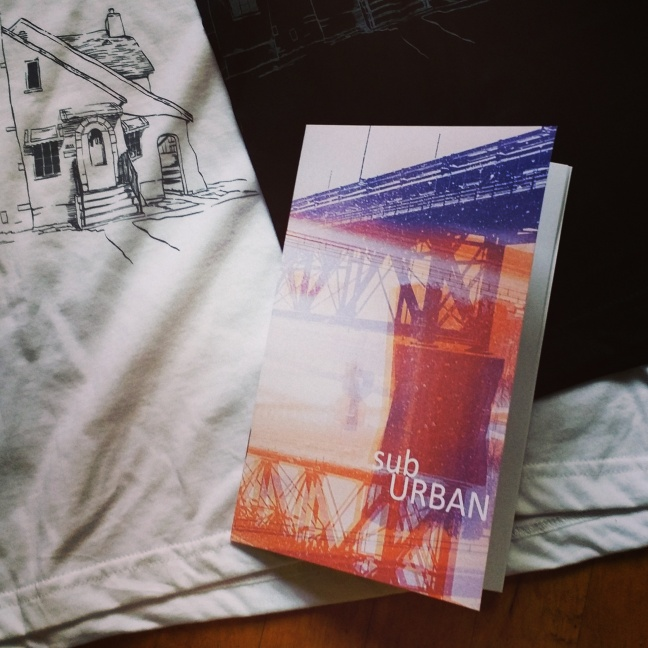 subURBAN catalogue resting on top of our hand printed CPI T-shirts, which feature an illustration by local designer - Patrick Kerby.